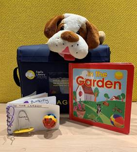 "Feelix library kit of ""In The Garden"" with plush dog and tactile story book"