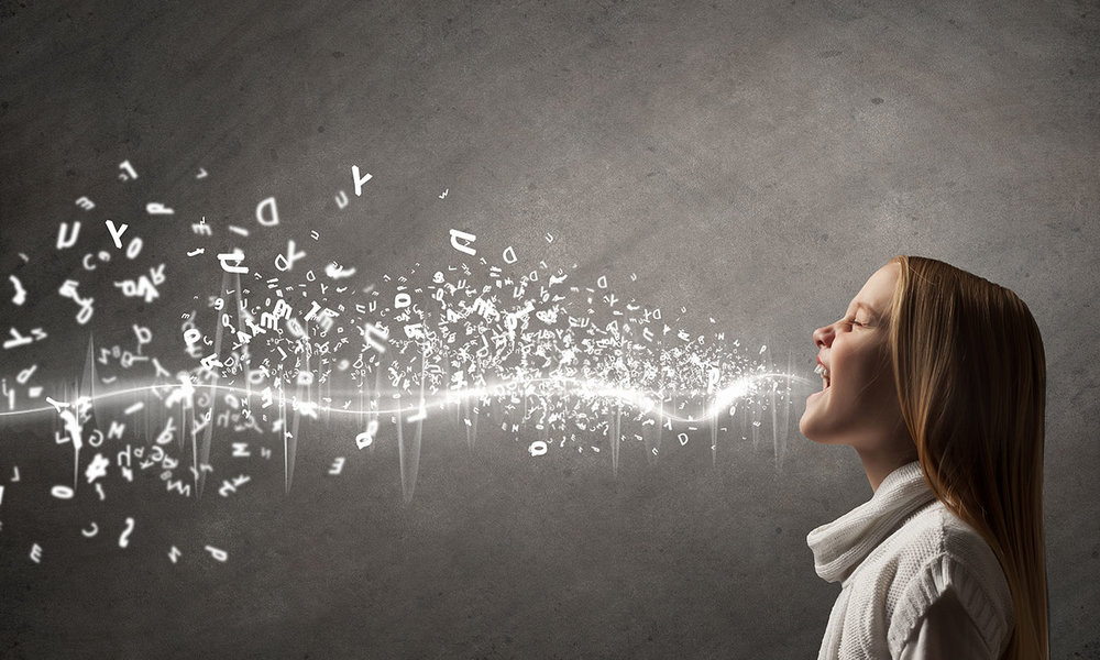 Woman with mouth wide open, bright stream of light is coming from her mouth surrounded by jumbles of letters